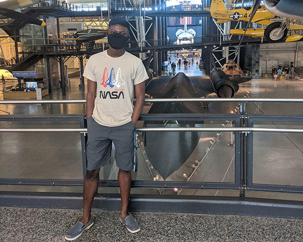 Sidney Boakye in the space museum in a NASA tshirt.